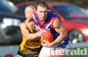 South Barwon big man Clinton Wells shows strength against Colac Tiger Kaden Newton at  Colac's Central Reserve.