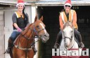 Colac track riders Michelle McDonald, left, aboard Diamonds at Noon, and Rachel Gane, aboard Spy School, train at Colac Turf Club in the lead up to the club's annual Christmas races.