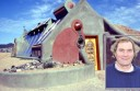 Tony Webber and a finished Earthship structure in New Mexico, in the United States.