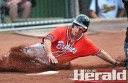 Colac Braves baseballer Dale Russell slides into home pate during a grand final victory
