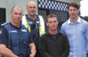 Leading Senior Constable Colin Cooper, Senior Constable Ray Doensen, and Apollo Bay surf lifesavers Quinn Matthews and Jake Cooper.