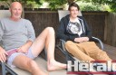 Lochie Donne, right, relaxes with his father Steve after returning home from hospital treatment for spinal injuries.