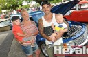 Larpent's Charles family, from left, Nash, 2, Ebony, Brock and Levi, eight months, with Brock's V8 Commodore at Colac's car show.