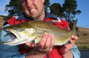 Fisheries Victoria creel survey officer Scott Gray holds a brown trout from Camperdown's Lake Purrumbete.