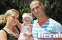Chloe Bamford and Ben Malouf with daughter Lily, who has recovered after she was born with a benign tumour.