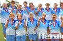 Colac bowlers celebrate their upset victory against powerhouse City in yesterday's Corangamite bowls Midweek Pennant grand final.