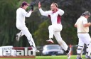 Stoneyford all-rounder Joe Dare, centre, celebrates the wicket of Leigh Garner with his brother Dom during Stoneyford's grabd final win against City United.