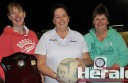 Melissa Kettle, centre, received Colac Summer Netball Association's Gwen Kenny Memorial Umpires Award from Kenny's daughters Sharyn Robinson, left, and Annette Robbins.