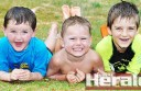 Tanner McNamara, 4, Jarryn Baker, 3, and Oliver Borch, 6, got under the sprinkler to cool down as Colac's temperature soared.