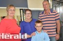 Tom Riches is pictured with his grandmother Jan Reynolds, centre, father Chris, and Joan Taylor of Colac's Meriba Club.