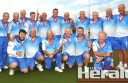 Colac lawn bowlers celebrate their Corangamite Bowls Division Saturday Pennant grand final victory against Simpson.