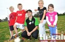 Colac Otway Rovers senior coach Dave Latham with youngsters Cooper Day, Oaklee Balboni, Emily Day and Zoe Ibbett.