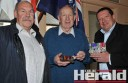 Colac detectives Chris Potter, left, and Mick Palmer, right, returned stolen medals to a relieved Reg O'Reilly.