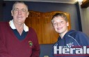 Colac Sportsmen's Club's Mick Melville, left, congratulates Josh Garner, 11, who is Victoria's new 12-and-under cricket captain. The Colac Sportsmen's Club gave Garner a donation of $500.