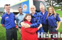 Apollo Bay heart attack survivor Stephen Morshead hugs wife Jenny after she, paramedics and doctors saved his life. The Morsheads are pictured with, from left, Ambulance Victoria's Wayne Malady, Doctor Mani Kutti, Ambulance Victoria's Lundon Darling and paramedic Gabriela Herrok.