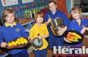 Winchelsea Primary School's Declan Brown, Spencer Stones, Sophie Larcombe and Tahlia Morgan enjoy the cooking component of the school's Stephanie Alexander kitchen-garden program.