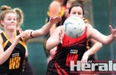 Simpson's Hayley Pouw attempts to spoil a ball directed towards Irrewarra-Beeac's Elissa Rodger during Saturday's match.