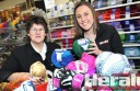 McMahon's Sandra Grant and Colac Herald's Morgan Eldridge check out wool the shop will discount during next week's Winter Walk-in Sale.