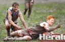Birregurra footballer Zak Day handballs under pressure from South Colac's Ben Lynch during the Saints' low-scoring win.