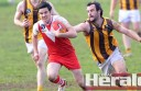 Apollo Bay defender Dean Scheetz chases Alvie's Anthony Laver during the Hawks' win against the finals-bound Swans.