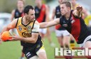Colac Tiger Khan Beckett eludes a tackle from Newtown and Chilwell star Jarrod McCorkell during the Tigers' victory.