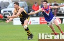 League powerhouse South Barwon is putting the pressure on teams in the top five, including the Colac Tigers, after overcoming a slow start to the season to win its past four games. Swans ruckman Fraser Fort is pictured chasing Colac's Lochie Veale.