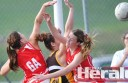 Apollo Bay goalkeeper Marlie Coutts is caught between Alvie goalers Mercedez Hickey, left, and Georgia Robinson.