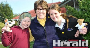 Cancer survivor Janine Benson and her daughters Siobhan, 9, and Caitlin, 13, will support the Cancer Council's Daffodil Day today. The Bensons know first-hand how the Cancer Council help families affected by cancer after they received help during Mrs Benson's fight with breast cancer.