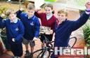 Colac's up-and-coming cyclists Ty Widdicombe, Adam McCarney, Kate Allan and Rupert McDonald celebrate cyclist Anna Meares' gold medal at the Glasgow Commonwealth Games.