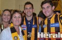 Colac AFL export Luke Hodge celebrates back-to-back premierships and his Norm Smith best-on-ground medal with sister Bianca, mum Leanne and brother Dylan after the Hawks defeated the Sydney Swans on Saturday. Hodge will go down in AFL history as one of only three players to have won two Norm Smith Medals.