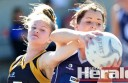 Colac Imperials' Kate Higgins, right, and Simpson's Kelly Pouw fight for a ball in Saturday's preliminary final at Central Reserve.