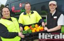 hurch volunteer Paul Loricco, SecondBite Geelong's Chris Revie and Coles Colac produce manager Jon Park display food the supermarket has donated to a Colac food program.
