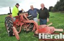 Colac and District Ploughing Association member Bob Clayton, left, helps founding members Hugh Riches and president Kelvin McNaughton prepare for 50th anniversary celebrations.