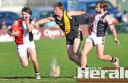 Birregurra footballer Tom Stephenson attempts to block Simpson's Jayden Rooke from getting to his teammate Lachlan Muir at Colac's Central Reserve on Saturday.