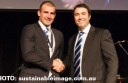 North Melbourne coach Brad Scott congratulates Cobden AFL export Ben Cunnington for winning the Roos' Syd Barker best-and-fairest medal.