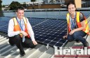 Colac Otway Shire Council's Doug McNeill and Dora Novak inspect the first of 370 photovoltaic solar panels which contractors are installing on the roofs of the council's Rae Street office and Colac Otway Performing Arts and Cultural Centre.
