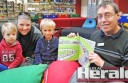 Colac library visitors Matthew Hislop, 3, Tanya Hislop, and Charlie Gardiner, 4, ready for story-time with librarian  Robert Cavalieri. Story-time attracts an average of 50 parents or carers and children, and up to 80 during busy weeks.