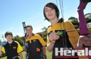 Young Colac archers Nick McLaren, 13, left, and Chris Inguanti, 13, right, will contest their first state titles  together at Geelong this weekend. The pair is pictured with experienced archer, and Nick's grandmother, Barb Kelly.