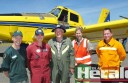 Otway district aviation fire crews joined for an annual training day. Pictured with an air-tractor water bomber from Stawell are, from left, DEPI Air Attack supervisor Simon White, Pilot Rob McIntosh, CFA Air Observer John Callahan, Parks Victoria aviation lead Sandra Robinson and CFA operations officer Byron Kershaw.