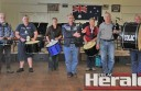 Colac Pipes and Drums members Darryl Steele, John Preston, Lois Kemp, Doug Moor, Christine Wilson, Mike Connor and Stan Welsh need more pipers and would welcome more drummers to keep the band playing. The band has enough drummers to support up to 12 pipers.