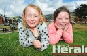 Lorne's Lyla Daly, 5, and Port Campbell's Millie Rogers, 7, pictured at Apollo Bay's foreshore, are among thousands of holidaymakers staying on the coast  during the festive season and January school holidays.
