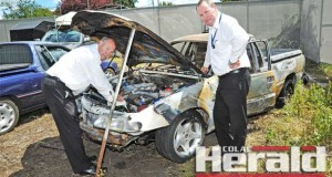 Detectives Chris Potter and Dave Renney inspect a burnt car at Colac Police Station. The car was set alight yesterday morning at Irrewarra Recreation Reserve.