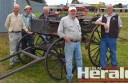 Colac Pastoral and Agricultural Society members, from left, Tony Steel, John McGee, Hugh Riches, Geoff Cross and Alan Billing standing next to a horse-drawn carriage which will be on display at Colac's Heritage Festival this weekend.