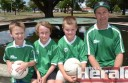 Colac Otway Rovers' Kingston Balboni, Liam McCullagh, Jack Skinner and Darren Balboni celebrate the soccer club's first junior team in a Geelong region under-13 competition.