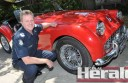 Colac Senior Sergeant, and motoring enthusiast Ken Slingsby and his prised 1958 Triumph.