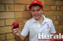 Alvie's Harry Carmody shows off the cricket ball he took a double hat-trick with in an under-14 match.