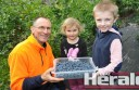 Gellibrand blueberry farmer Wayne Knight pictured with his grandchildren Hamish Knight and Emily Agnew, says a recall on imported frozen berries should boost interest in Australian-grown produce. The recall stemmed from contamination of imported berries with the infectious disease hepatitis A, causing people to fall ill.