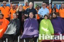 AKD Softwoods employees including AKD chief Shane Vicary, front third from left, shaved or coloured their hair for a cancer fundraiser. Colac Otway Shire Council chief executive officer Sue Wilkinson and members of Colac's police and fire brigade were also involved in the fundraiser, which raised more than $20,000.