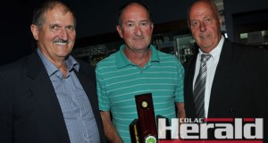 Colac Otway Shire mayor Frank Buchanan, left, and Colac Sportsmen's Club president David Schram, right, awarded Colac district shooter Martin Bramley as the club's 2014 Sports Star of the Year.