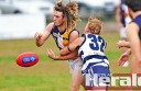 Colac Imperials' Jeremy Spokes wraps up Western Eagles best-on-ground player James Beasley during the Imps' win at Western Oval.